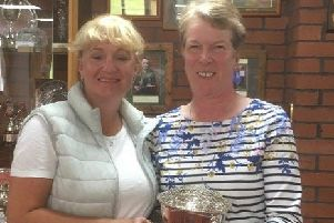 Lady captain Karen Rawson (left) presents Sue Booth with the Keymin Trophy. EMN-190907-121307002