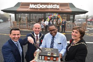 Franchisee Matthew Jarrett and operations supervisor Marcus Dugasse at the re-opening of McDonald's at Eye in 2015 with the then Mayor of Peterborough John Peach and Mayoress Janet Martin.
