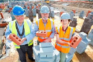 The sod-cutting ceremony at St Rumbold's Fields in Buckingham - pictured from left are Buckingham mayor Mark Cole, Chris Harkin, contracts manager at Barrett Homes and Carolyn Cumming from the Buckingham Society