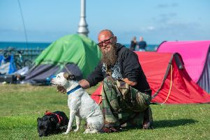 Resident Lez, with dogs Piccolo and Cymro. Picture: Tony Kershaw / SWNS