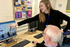 Amy and John at an Age UK IT drop-in session