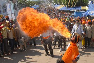 One bag of chilli-flavoured crisps too many?  An Indian Sikh performs fire-breathing during a religious procession to mark Hola Mohalla.  Photo by Shammi Mehra/AFP/Getty Images)