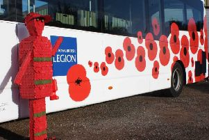The Brighton & Hove Buses poppy bus with a poppy covered soldier scultpure. The bus company will offer free travel to veterans and serving members of the armed forces this Remembrance Sunday (November 10).