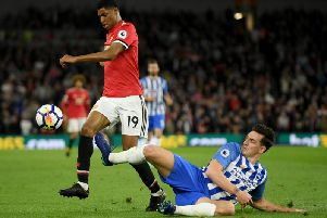 Brighton and Hove Albion skipper Lewis Dunk will hope to keep Marcus Rashford quiet at Old Trafford this Sunday