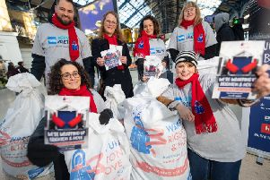 American Express colleagues collecting coats at Brighton Station
