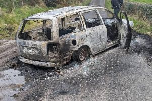 The burned out car abandoned by the attackers at Lisnamuck Road, Maghera.