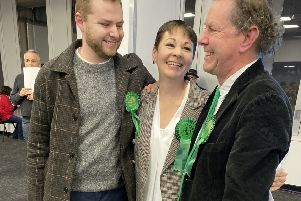 Caroline Lucas with husband Richard Savage and one of their two sons