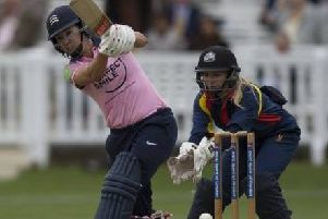 Chloe Hill (back) keeps wicket for the MCC against Middlesex in a Women's Day cricket match at Lord's