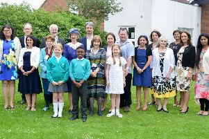 The High Sheriff (centre) is joined by new citizens, chairman Netta Glover, cabinet member Noel Brown, headteacher Pat Gurton, the county council registration team, and pupils Freya and Andrew, who helped present certificates