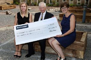 Winslow CofE School governor and headteacher receives donation from Bloor Homes