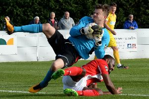Brackley Town's Daniel Nti is thwarted by Spennymoor Town keeper Matthew Gould. Photo: Jake McNulty