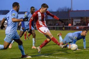 Brackley Town's Liam McAlinden gets in  a shot against Hayes & Yeading United. Photo: Jake McNulty