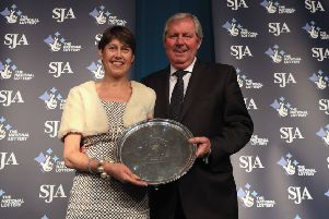 Vikki Orvice presenting The JL Manning Award for services to sport to Brendan Foster during The SJA British Sports Awards 2017 (Photo by Andrew Redington/Getty Images)