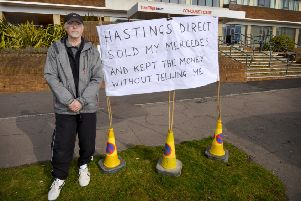 Grahame Hedgecock protesting outside Hastings Direct in Collington.