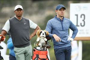 Rory McIlroy and Tiger Woods during the their quarter-final matchplay tie at Austin