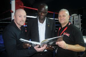 Ady Bush, right, with Franco Wanyama and Edwin Cleary at a Cleary's show in 2012.