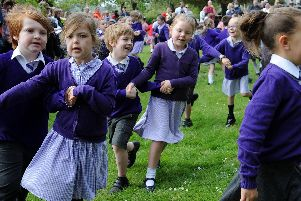 Pupils from the George Grenville Academy take part in Mayday dancing in Buckingham