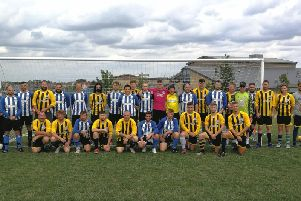 Buckingham United (blue and white stripes) and The Mitre (amber and black stripes) football teams