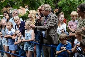 Archive photo from last year's University of Buckingham duck race - the announcement of the winner