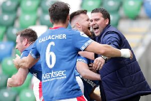 Linfield manager David Healy and his players celebrate late derby success over Glentoran. Pic by Pacemaker.