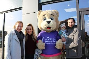 Deborah Gould, Director of Retail and Trading at Rennie Grove, with Ellie, Harvey and Oli at the shop opening in Berryfields