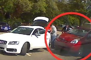 Police cam image showing a thieves stealing a catalytic converter