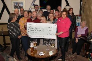 Trevina (centre) with Liza (right) from Florence Nightingale during the cheque presentation evening at The Prince of Wales pub