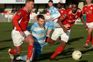 Brackley Town skipper Gaz Dean and Thierry Audel snuff out the danger against Farsley Celtic. Photo: Jake McNulty