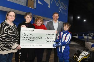 Jenson hands over a cheque of 760 to BuDs yesterday