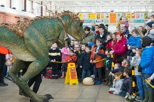 A T-Rex approaches the crowd