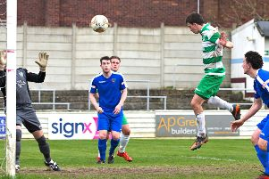 United captain Jack Wood heads home on his 400th appearance for the club. Picture: Mike Snell