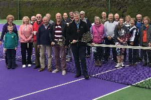 Warsash members gathered to celebrate the reopening of their courts which have been resurfaced and repainted in Wimbledon green and purple colours