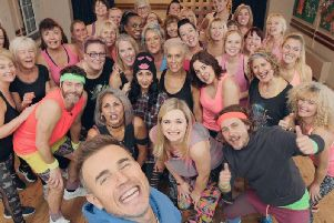 Catherine got the surprise of her life when the band popped in to take part in her dance class  and her experience has now been turned into a primetime TV advert.