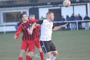 Zack McEniry holds off an opponent during Bexhill United's 4-0 win at home to Worthing United. Picture by Simon Newstead