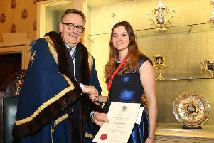 Becky Simmonds receives her award from the Worshipful Company of Saddlers' Prime Warden, James Welch