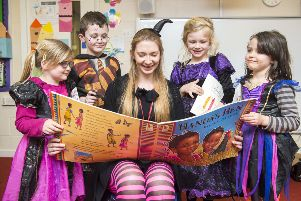 Year One pupils Phoebe Gill, Cameron Harvey, Olivia Randle and Elissia Alan enjoy an exciting story at Theddlethorpe  Academy.
