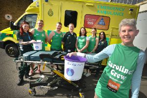 Caroline Stannard and some of the ambulance staff in Hastings who will be running the half marathon with a stretcher