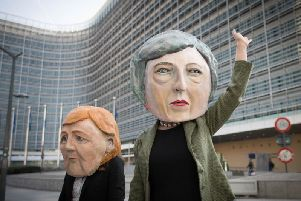 Anti Brexit protesters dressed as Theresa May and Angela Merkel outside the EU Commission in Brussels ahead of the European Leaders' summit at which Prime Minister Theresa May will be asking for an extension to Brexit. Picture: Stefan Rousseau/PA Wire