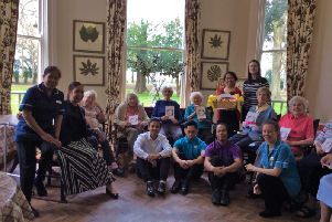 Residents at Bartlett's Residential Care Home in Stone with their new poetry book