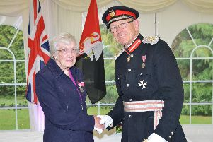 Joyce Rutter receiving the British Empire Medal