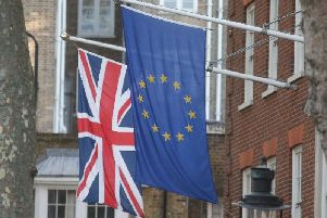 An EU flag flies next to the Union Jack