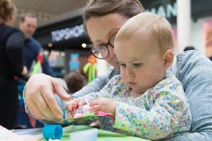 There was fun for everyone at the Friars Square family fete last week - here one-year-old Nina Nevin enjoys some crafty fun with her mum
