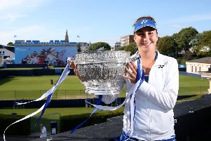 Belinda Bencic poses with the trophy after defeating Agnieszka Radwanska in the 2015 final at Devonshire Park