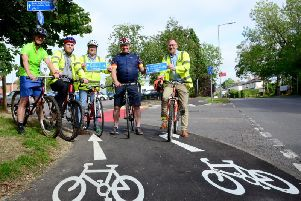 From left councillors Charlie Clare, Paul Irwin, Mark Shaw and Warren Whyte. In the blue is Bucks cycling champion Clive Harris officially opening the extension to the cycleway
