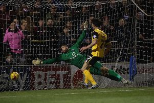John Marquis scores for the Cobblers against York in 2016. Picture: Getty.
