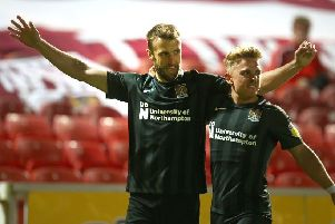 Andy Williams celebrates his winning goal with team-mate Sam Hoskins (Picture: Pete Norton)