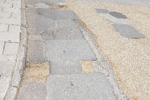 A patched stretch of road in West Street, Midhurst