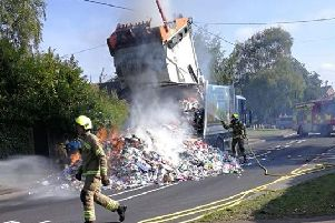 Fire fighters respond to a previous truck fire