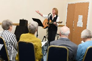 Isla St Clair leads the singing as Cafe Zest celebrates its first birthday