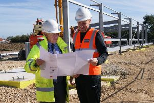 David Newton and Craig Elliott check out the plans.